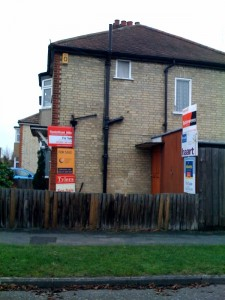 A house on my street with no fewer than 6 estate agent boards.